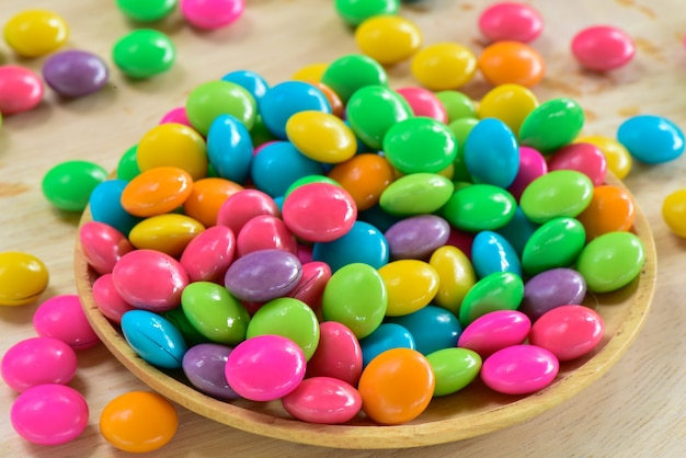 Colorful chocolate candy in wooden container