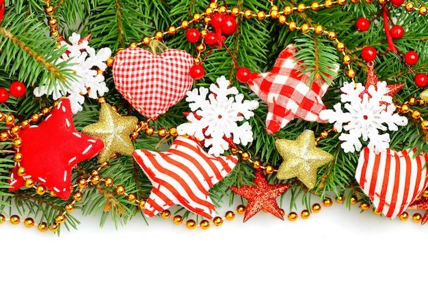 눈송이, 녹색 크리스마스 트리 나뭇 가지와 빨간색 수제 별 화려한 크리스마스 테두리