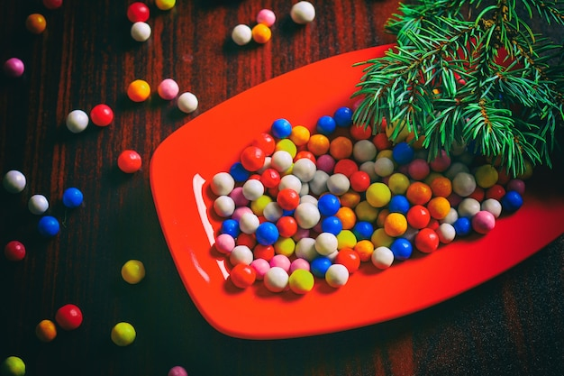Colorful christmas candies on plate