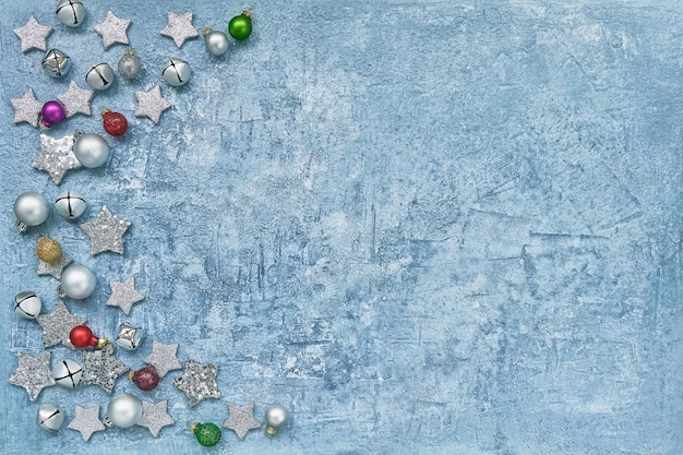 Colorful christmas decoration on bright blue background. top view, copy