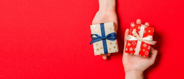 Colorful christmas gift box in hands