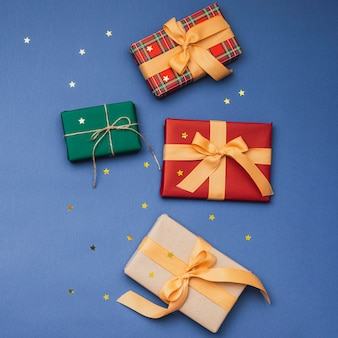 Colorful christmas gifts with ribbon and golden stars