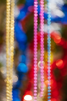 Colorful christmas ornament decorations defocused abstract blurry bokeh background of balls