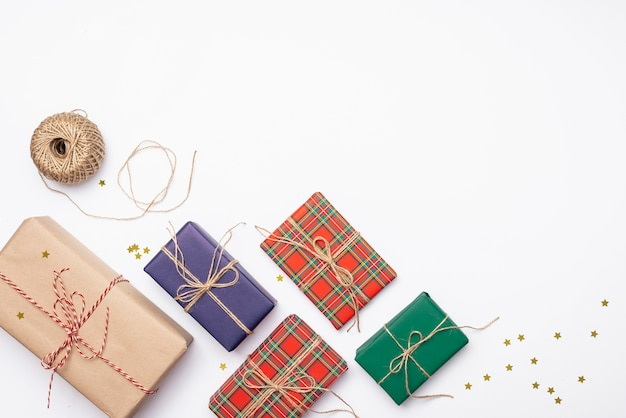Colorful christmas presents with golden stars and string
