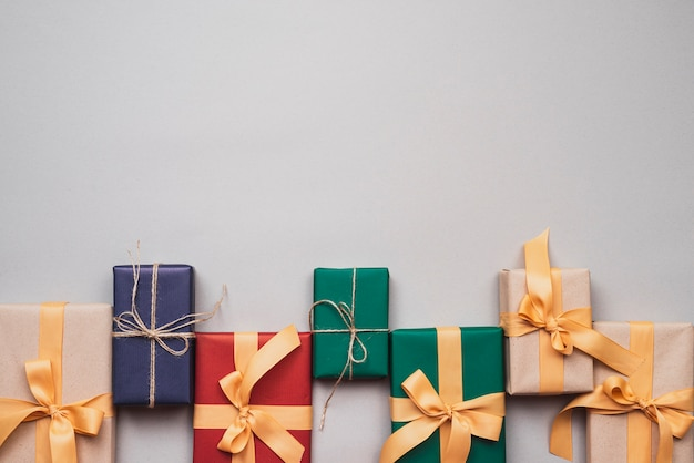 Colorful christmas presents with ribbon and copy space