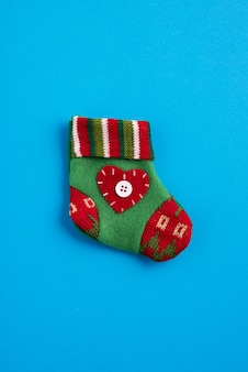 Colorful christmas sock in the blue background