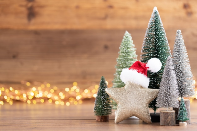 Colorful christmas tree on wooden, bokeh background