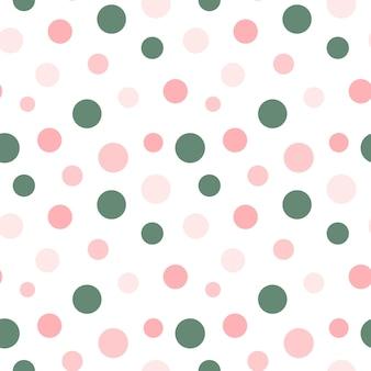 白い背景のシームレスなパターンのカラフルな円ピンクと緑の水玉模様のリピートプリント