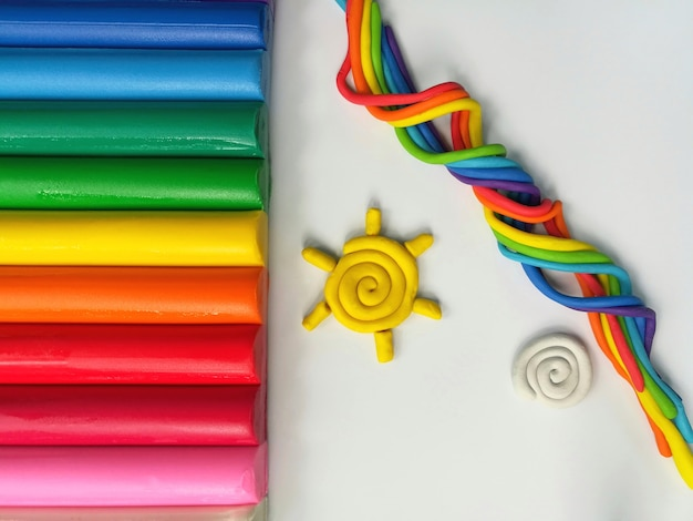 Colorful clay plasticine sticks sun cloud and rainbows colored dough