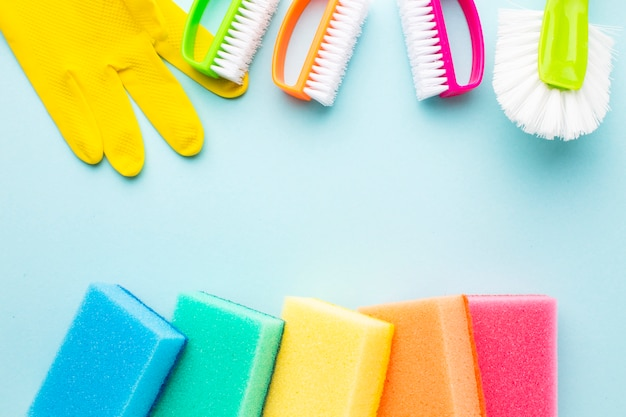 Colorful cleaning products copy space