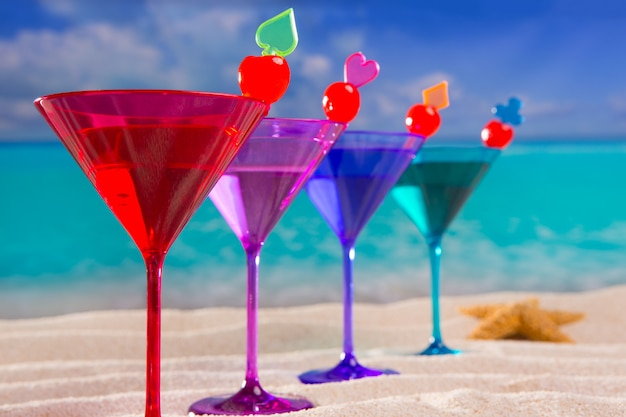Colorful cocktail in a row with cherry