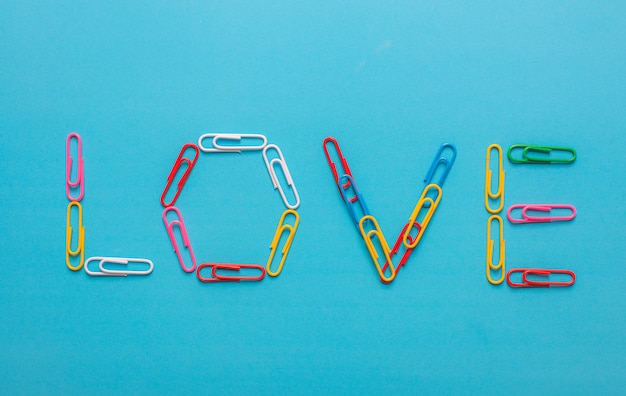 Colorful collection of paper clips forming the word