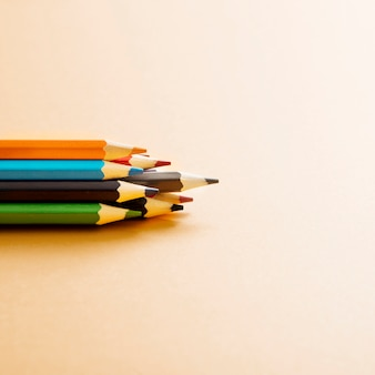 Colorful colored pencil on beige background