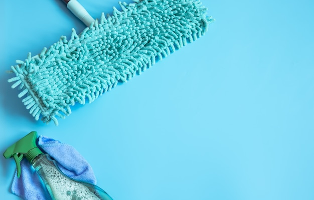 Colorful composition with mop and glass cleaner flat lay. cleaning company service concept.