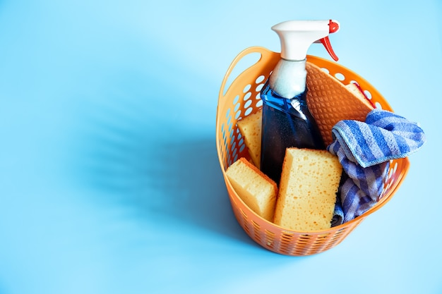 Colorful composition with a set of bright cleaning sponges and cleaning agent.