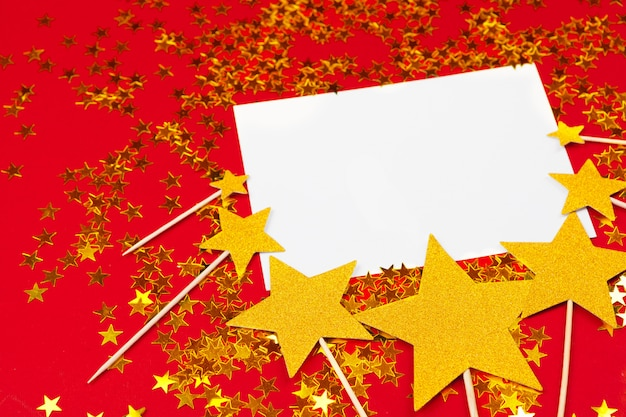 Colorful confetti background. gold, red with copy space