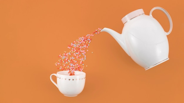 Colorful confetti flowing from teapot in the white cup against brown backdrop