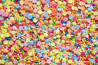 Colorful confetti sprinkles textured background
