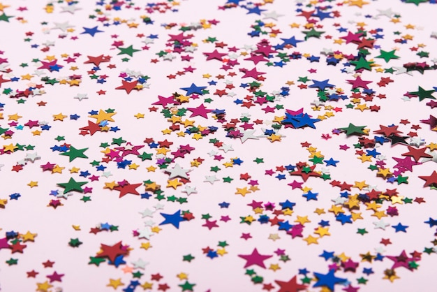 Colorful confetti stars on the background