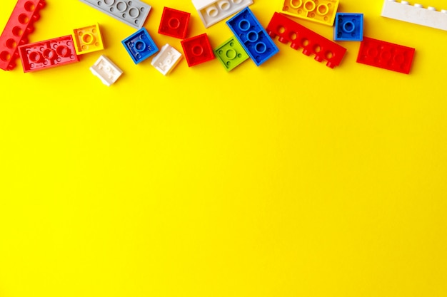 Colorful construction bricks for kids. preschool activity with little children.