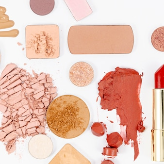 Colorful cosmetics on white background