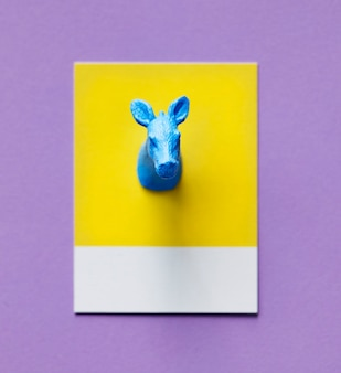 Colorful cow figure on a paper