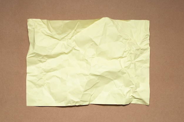 Colorful crumpled paper on kraft paper