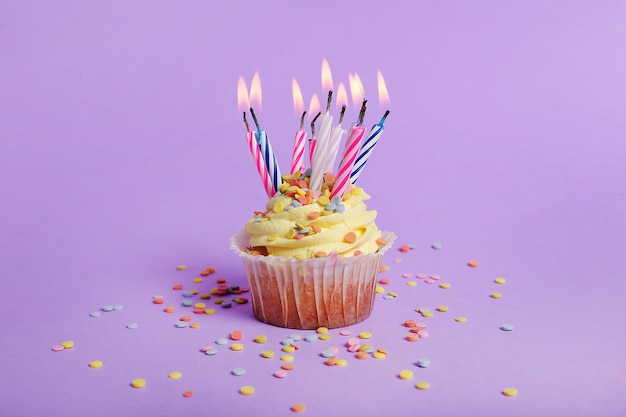 Colorful cupcake with candles