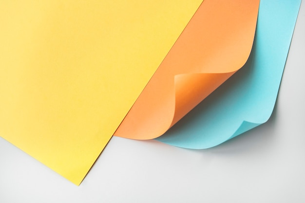 Colorful curled paper on a gray background