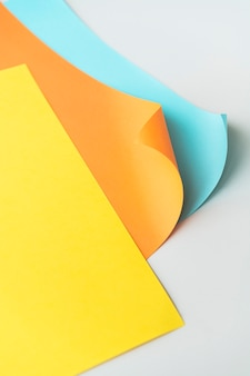 Colorful curled paper on a gray