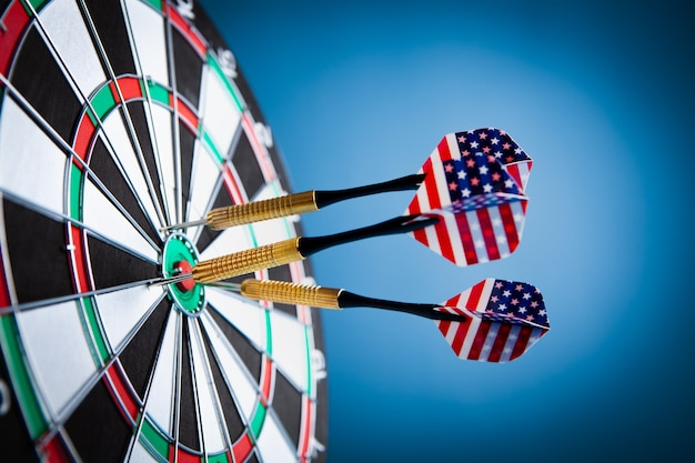Colorful darts on dart board