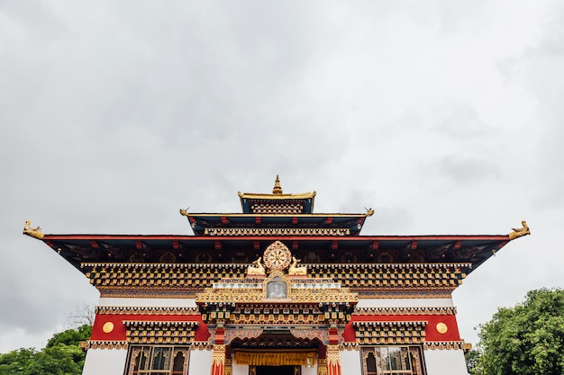 Colorful decorated facade in bhutanese style of the royal bhutanese monastery.
