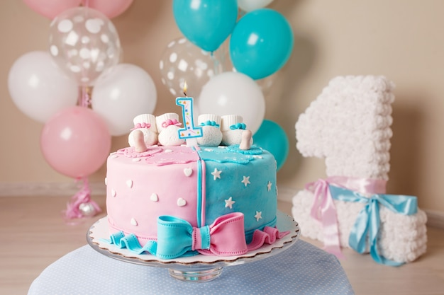 Colorful decoration of a first year birthday cake for twins