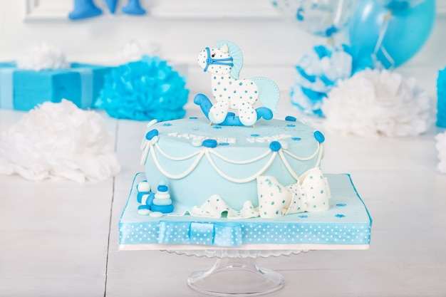 Colorful decoration of a first year birthday cake