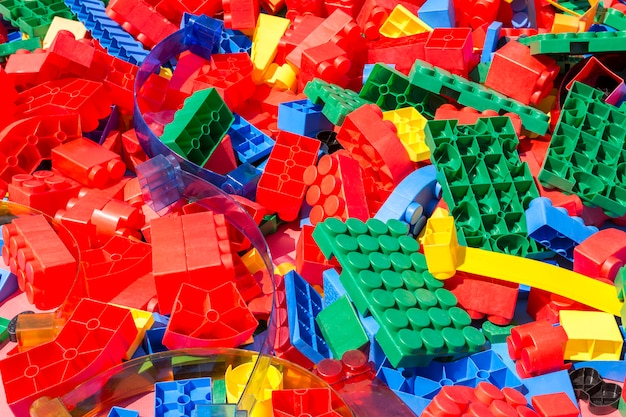 Colorful details of children's plastic designer under the bright sun.