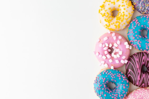 Colorful donuts arrangement close up
