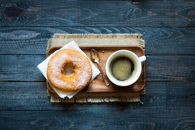 Colorful donuts and coffee breakfast composition with different color styles
