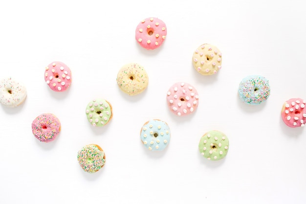 Colorful donuts. flat lay, top view minimal pattern.