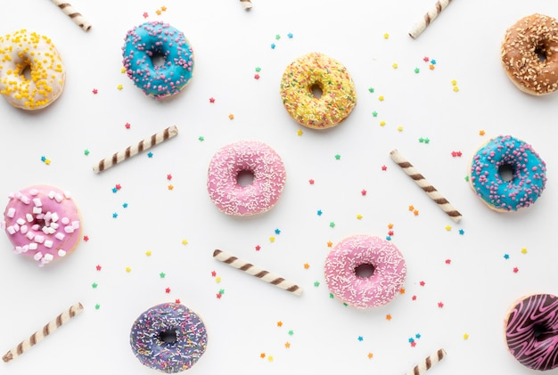 Colorful donuts in flat lay