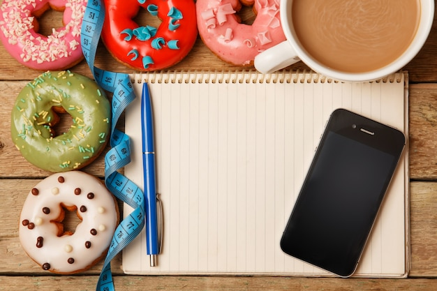 Colorful donuts and notepad