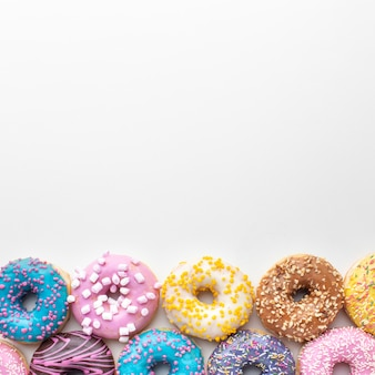 Colorful donuts overhead view