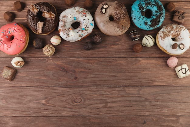 Colorful donuts with chocolate