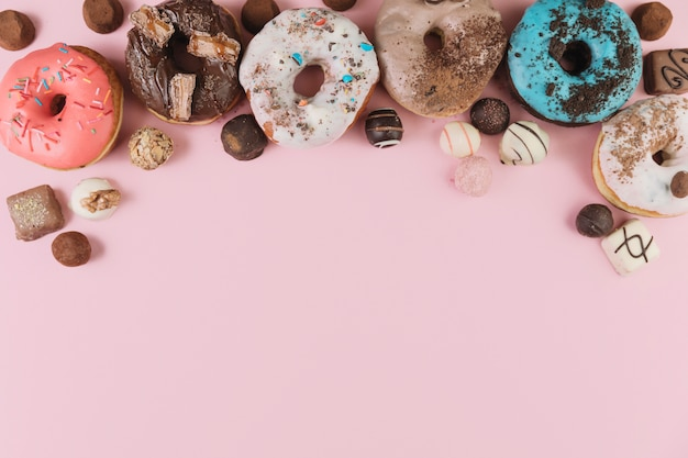 Colorful donuts with chocolates