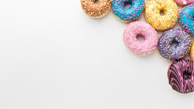 Colorful donuts with copy space