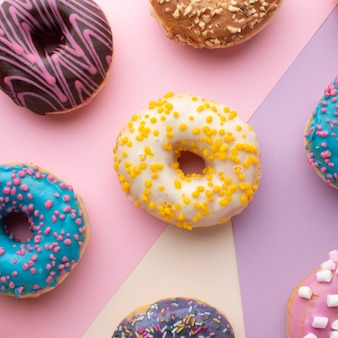 Colorful donuts with sprinkles close up