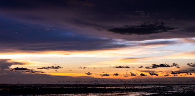 Colorful dramatic sky over the sea after the sunset
