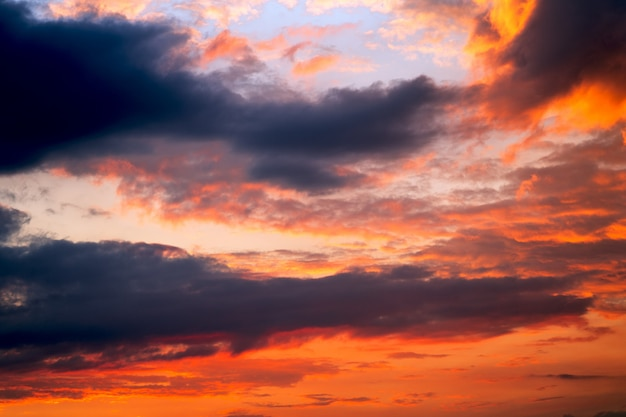 Colorful dramatic sky with clouds at sunset.