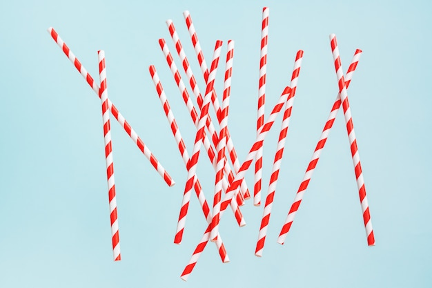 Colorful drinking straws for beverage on a bright background. birthday festive cheerful background.