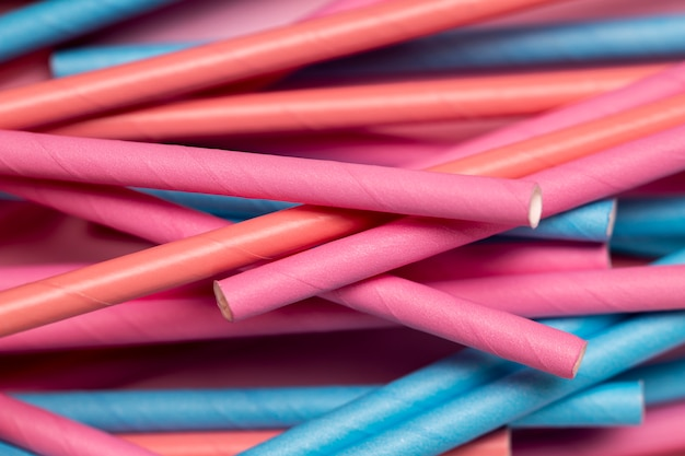 Colorful drinking straws on table