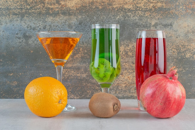 Colorful drinks with fruits on marble